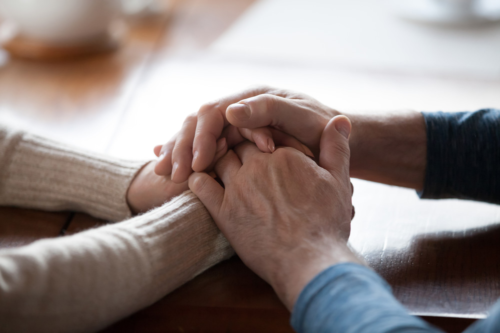 Old aged people holding hands and caring for each other. Psychological support is an integral part of our services at Haym Salomon Home for Nursing and Rehabilitation in Brooklyn.