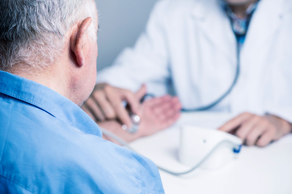 Doctor checking patient pulse to determine if they have irregular hearbeats