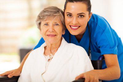Nurse taking care of elderly women suffering from sleeplessness.