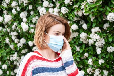 Women wearing mask to protect herself from spring allergies