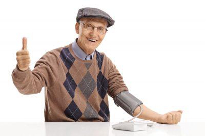 A senior man measuring changes in blood pressure