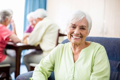 An elderly women smiling and enjoying daily leisure activities provided at Haym Salomon Home For Nursing & Rehabilitation