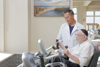 An elderly patient getting exercise as a part of cardiac rehabilitation at Haym Salomon Home For Nursing & Rehabilitation