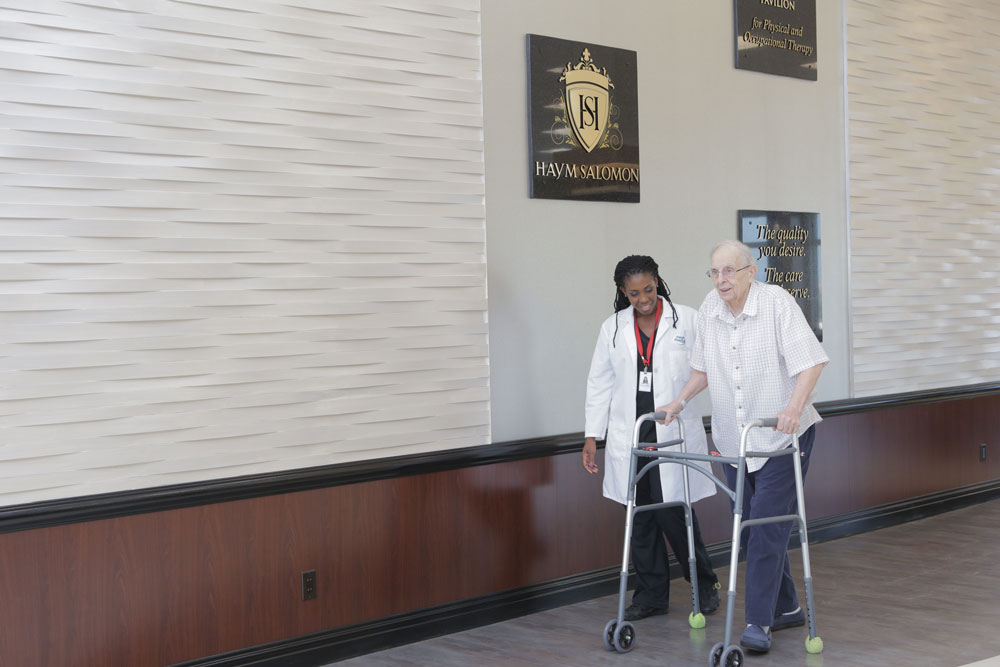 Elderly man getting physical therapy after bypass surgery