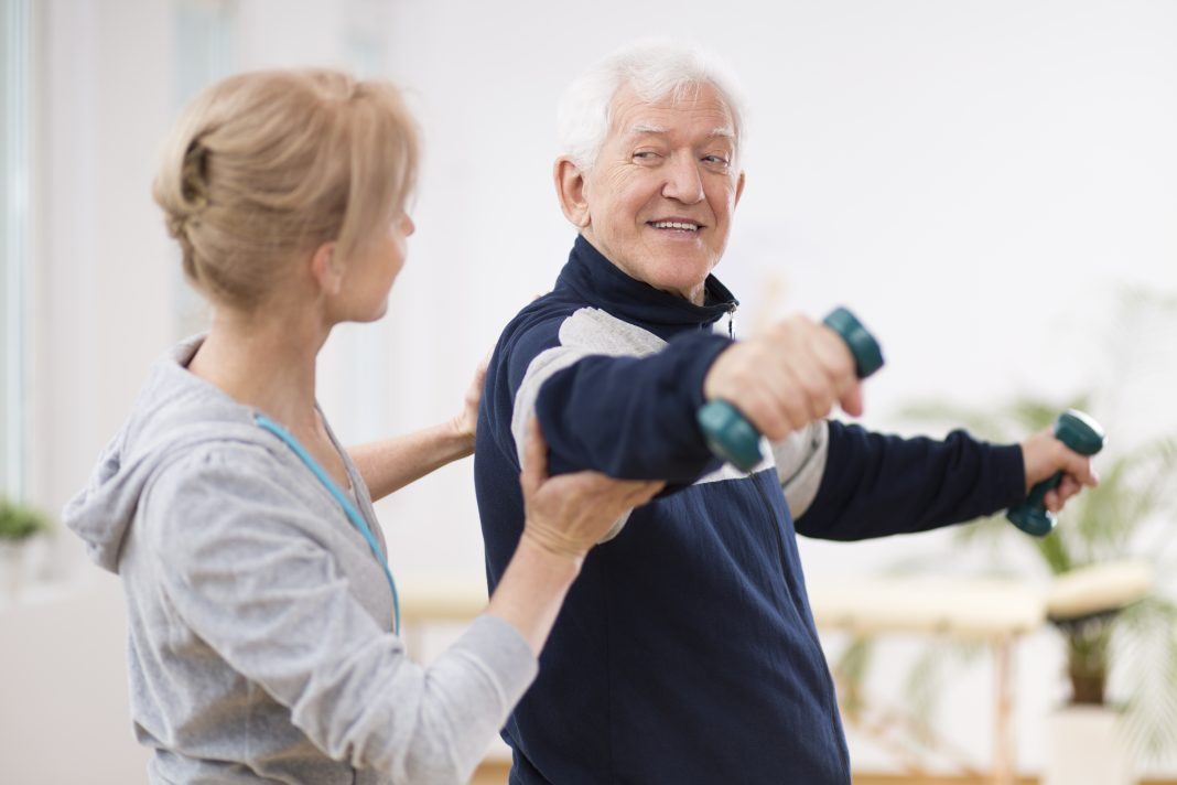 Elderly man getting physical therapy and rehab after stroke