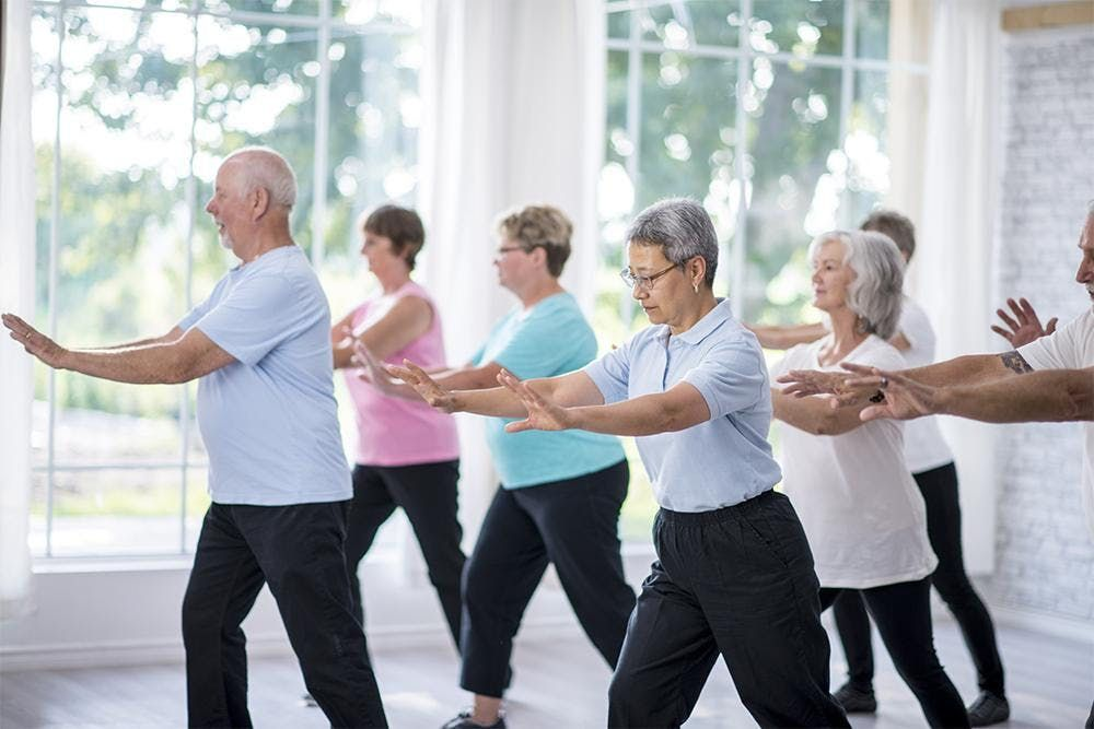 Elderly people exercising to boost their immune system