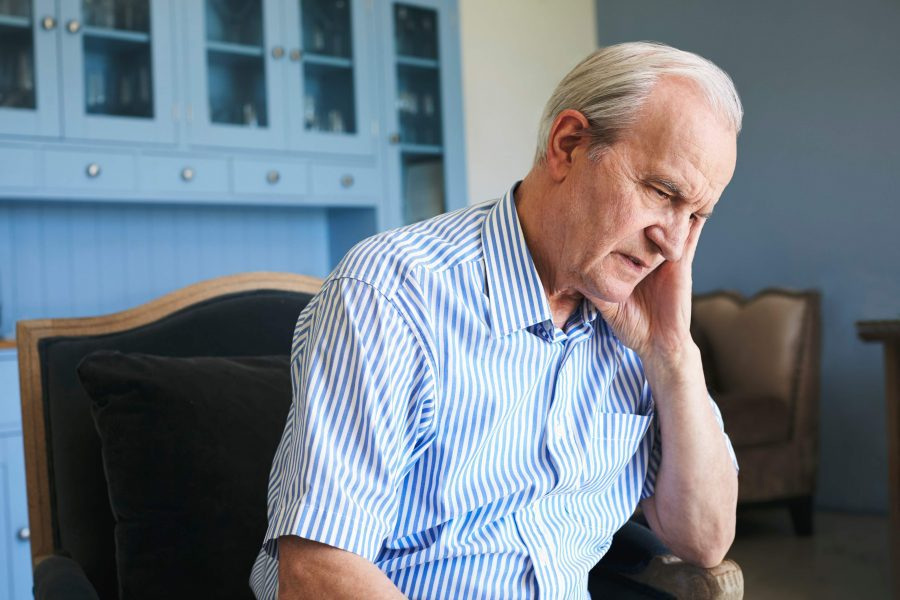 Elderly man sitting and worried about how to stop cognitive decline