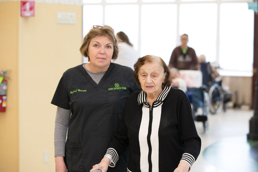 Elderly women getting stroke rehabilitation to recover from a stroke