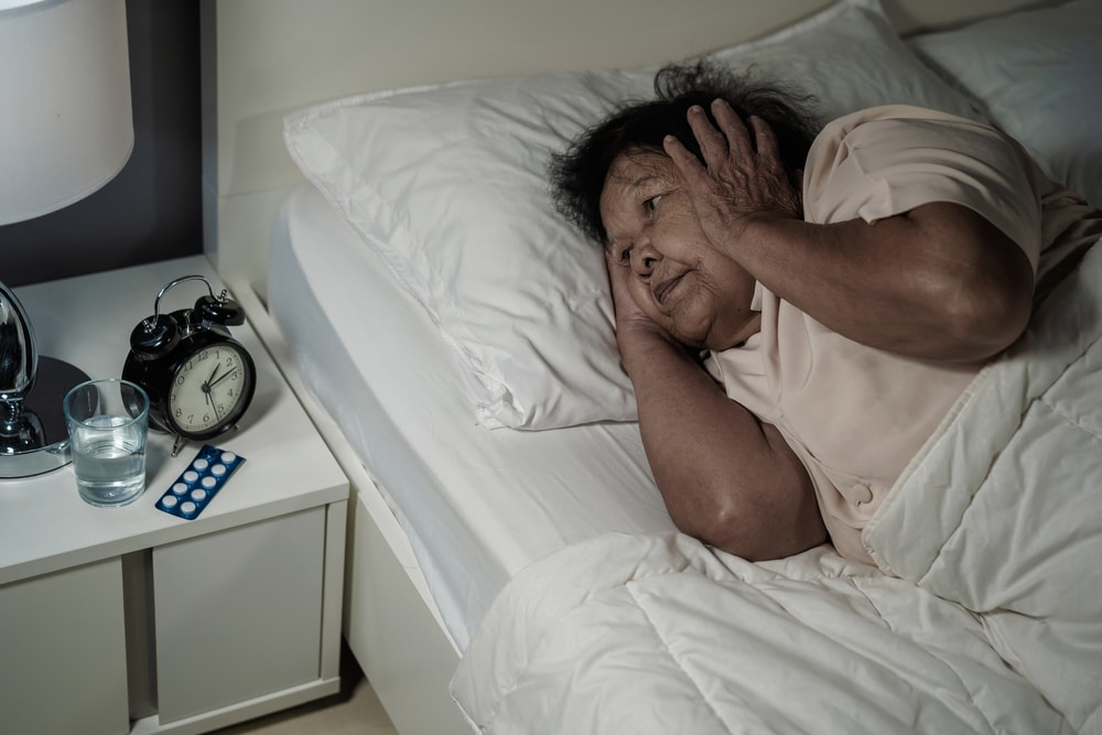 elderly old woman suffering from sleep apnea and could not sleep