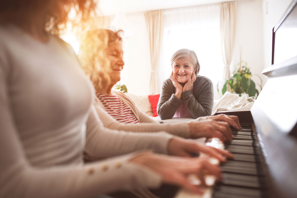Elderly woman playing piano to relax the mind using the benefits of music