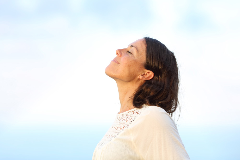 Side view portrait of a woman breathing fresh air