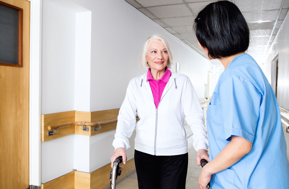 Elderly woman getting physical therapy as a part of rehab after knee surgery