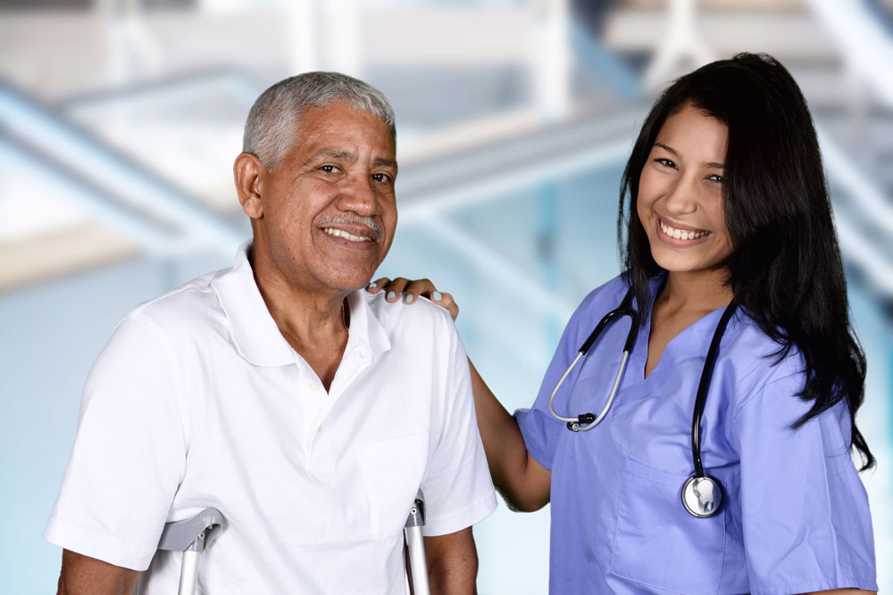 Nurse and patient smiling after a session of Pulmonary Physical Therapy