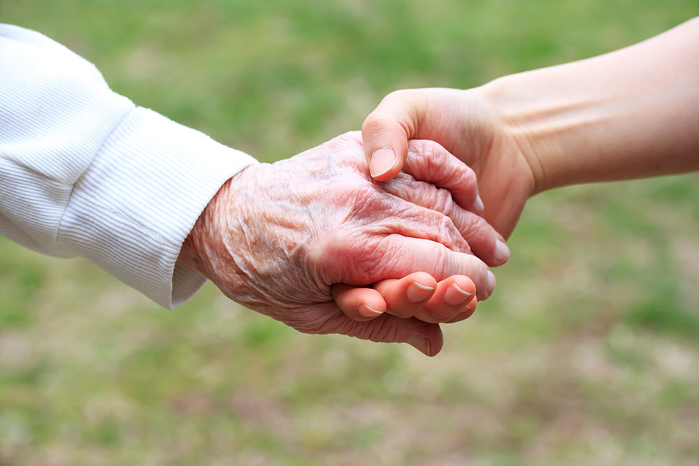 Senior and Young Women Holding Hands to tackle loss of independence
