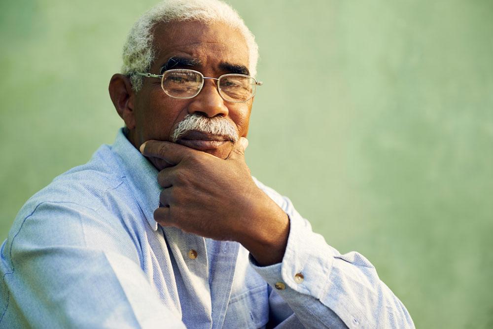 Portrait of an elderly black man getting nursing home care
