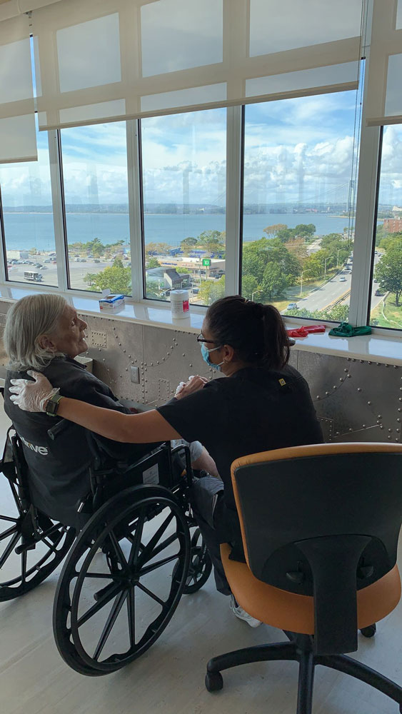 Elderly woman on wheel chair getting compassionate care at Haym Salomon Home